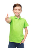 Happy boy in green polo t-shirt showing thumbs up Stock Images