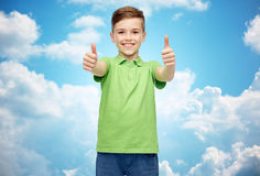 Happy boy in green polo t-shirt showing thumbs up Royalty Free Stock Photography