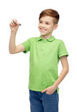 Happy boy in green t-shirt with marker writing Royalty Free Stock Images