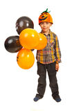 Happy boy with Halloween balloons. Happy boy hholding Halloween balloons isolated on white background Royalty Free Stock Images