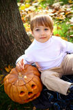 Happy boy with halloween pumpkin Royalty Free Stock Images