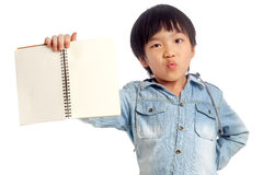 Happy boy with hand holding notebook. On white background Royalty Free Stock Photography