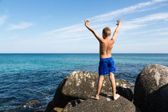 Happy boy with hands raised Royalty Free Stock Images