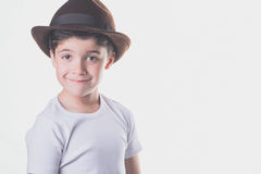 Happy boy. With hat on a white background Royalty Free Stock Photos