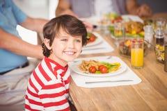 Happy boy having breakfast with family Royalty Free Stock Photography