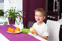 Happy boy having breakfast Stock Image