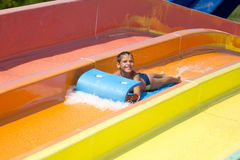 Happy boy  having fun in aqua park Royalty Free Stock Photo