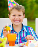 Happy boy having fun at birthday party Stock Images