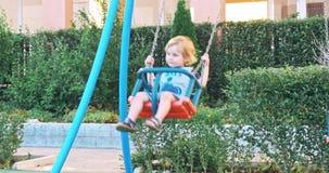 Happy boy having fun in kids amusement park stock video