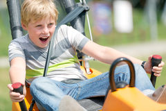 Happy boy having fun at summer bobsled track Stock Images
