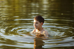 Happy boy having fun swimming in the water Royalty Free Stock Photography
