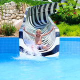 Happy boy having fun in water park royalty free stock images