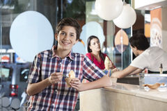 Happy Boy Having Ice Cream At Parlor Royalty Free Stock Images