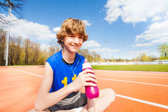 Happy boy having rest after gymnastic activity Royalty Free Stock Image