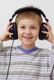 Happy boy in headphones Royalty Free Stock Images