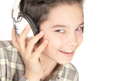 Happy boy with headphones. Smiling boy with headphones on the white Royalty Free Stock Photo