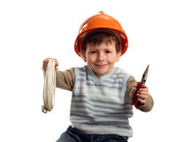 Happy boy in helmet with pliers and cable Royalty Free Stock Images