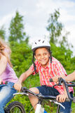 Happy boy in helmet riding a bike Stock Photos