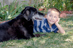 a happy boy and his  best dog Royalty Free Stock Image