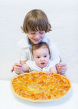 Happy boy and his cute  eating pizza. Happy boy and his cute little eating pizza Royalty Free Stock Photography