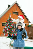 The happy boy with his father and Christmas tree Stock Photography