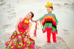 Happy boy and his mother wearing Mexicans Royalty Free Stock Images