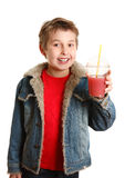 Happy boy hold fresh fruit juice Royalty Free Stock Photo
