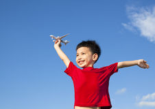 Happy boy holding a airplane toy and open arms Royalty Free Stock Image