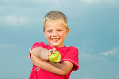 Happy boy holding apple Royalty Free Stock Photos