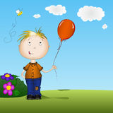 Happy boy holding a balloon Royalty Free Stock Photo