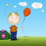 Happy boy holding a balloon Royalty Free Stock Photo