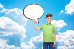 Happy boy holding blank white text bubble banner Royalty Free Stock Photography