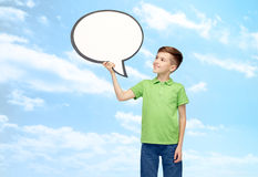 Happy boy holding blank white text bubble banner Royalty Free Stock Photos