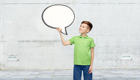 Happy boy holding blank white text bubble banner Royalty Free Stock Image