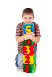 Happy boy holding blocks with numbers Stock Image