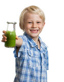 Happy boy holding bottle of green smoothie stock photography
