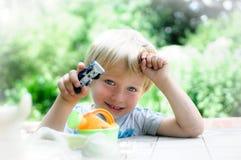 Happy boy holding a car Royalty Free Stock Photo