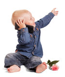Happy boy holding cell phone, hand is directed towards . Royalty Free Stock Photography