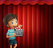 Happy boy holding clapboard Royalty Free Stock Image