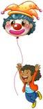 A happy boy holding a clown balloon Royalty Free Stock Photos