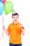 Happy boy holding colorful balloons. Royalty Free Stock Images