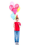 Happy boy holding colorful balloons. Royalty Free Stock Photography