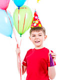 Happy boy holding colorful balloons. Stock Photos