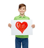 Happy boy holding drawing or picture of red heart Royalty Free Stock Photo