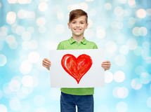 Happy boy holding drawing or picture of red heart Royalty Free Stock Images