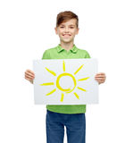 Happy boy holding drawing or picture of sun Royalty Free Stock Images