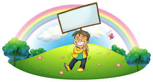 A happy boy holding an empty signboard royalty free illustration