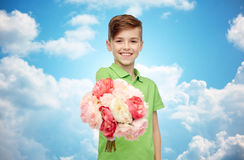 Happy boy holding flower bunch Royalty Free Stock Image