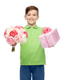 Happy boy holding flower bunch and gift box Stock Image