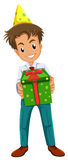 A happy boy holding a gift Stock Image